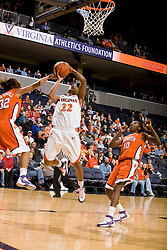 Virginia guard Monica Wright (22) shoots over Clemson guard Morganne Campbell (32).  The Virginia Cavaliers women's basketball team defeated the Clemson Tigers 83-71 at the John Paul Jones Arena in Charlottesville, VA on February 21, 2008.