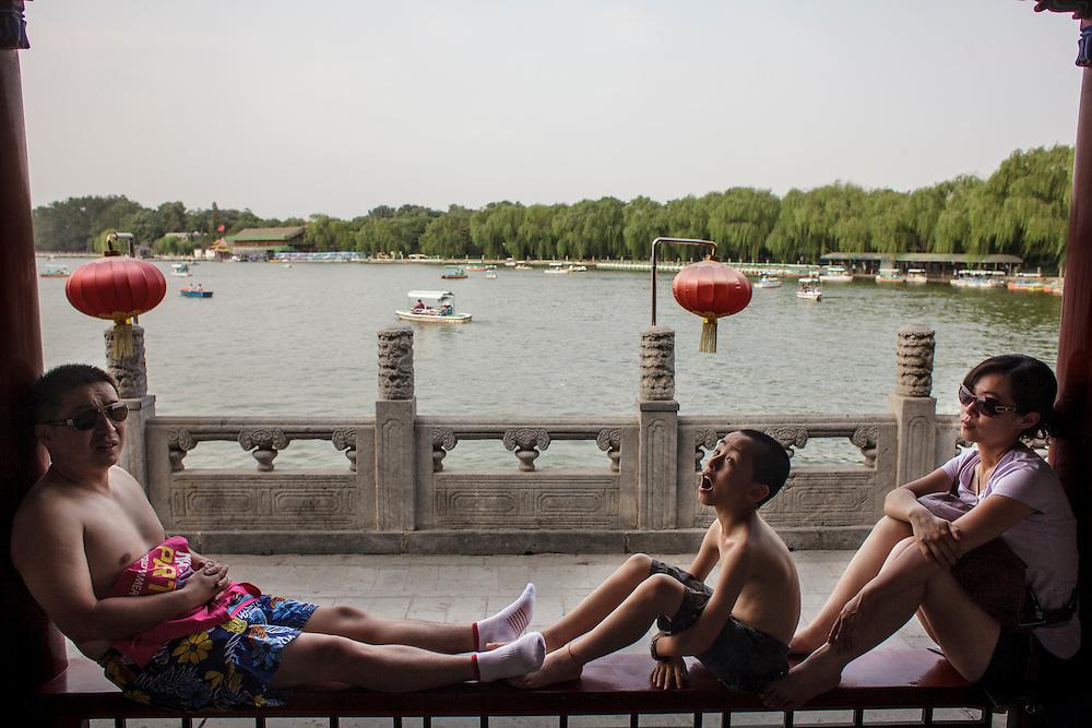 Families enjoying a rest at Behai Park in Beijing.