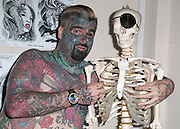 """EXCLUSIVE<br /> Britain's most tattooed man """"King Of Ink Land"""" has had is nipple removed in this latest bizarre twist King of ink as he is now known<br /> spent friday morning having his nipple removed,<br /> <br /> King of ink said """"I have never really found my nipples attractive. In fact I just didn't like them. My girlfriend will miss them as she use to enjoy biting them something that comes a little bit erotica, However I am pleased to finally have them removed. It was not in the least painful however the next week or two I will be a,little sore.<br /> <br /> he went to say<br /> <br /> We will always respect our bodies.<br /> <br /> We believe it is our right to explore our world, both physical and supernatural, through spiritual body modification.<br /> <br /> We promise to always grow as individuals through body modification and what it can teach us about who we are and what we can do.<br /> <br /> We vow to share our experiences openly and honestly in order to promote growth in mind, body, and soul.<br /> <br /> We honor all forms of body modification and those who choose to practice in safe and consensual ways.<br /> <br /> We also promise to respect those who do not choose body modification.<br /> <br /> We support all that join us in our mission and help those seeking us in need of spiritual guidance.<br /> <br /> We strive to share a positive message with everyone we encounter, in order to act as positive role models for future generations in the body modification community.<br /> <br /> We always uphold basic codes of ethics and encourage others to do the same.<br /> when asked about his latest body transformation he replied <br /> <br /> """"I may practice rituals and body modification without prejudice or discrimination. By acting responsibly and with integrity, I wish to observe our sincerely held religious beliefs without restriction""""<br /> ©Exclusivepix"""