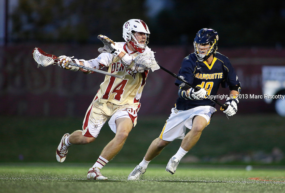 SHOT 4/5/13 6:33:10 PM - The University of Denver's Wesley Berg #14 tries to fend off Marquette's Charley Gargano #19 during their NCAA Men's Lacrosse game at the Peter Barton Lacrosse Stadium on the University of Denver's campus. The University of Denver won the game 15-4.(Photo by Marc Piscotty / © 2013)