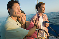 Couple with friend relaxing on yacht