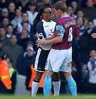 Photo: Daniel Hambury.<br />Tottenham Hotspur v West Ham Utd. The Barclays Premiership. 20/11/2005.<br />Spurs' Edgar Davids and West Ham's Teddy Sheringham square up to one another.