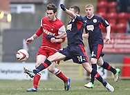 Picture by David Horn/Focus Images Ltd +44 7545 970036.23/02/2013.Romain Vincelot of Leyton Orient is beaten to the ball by Mike Jones of Crawley Town during the npower League 1 match at the Matchroom Stadium, London.