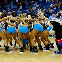 Mar 22, 2013; New Orleans, LA, USA; Detroit Pistons mascot Hooper keeps an eye on the New Orleans Honeybees dance team during a halftime performance of dancers versus mascots for a game between the New Orleans Hornets and the Memphis Grizzlies at the New Orleans Arena.  Mandatory Credit: Derick E. Hingle-USA TODAY Sports