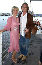 designer LINDKA CIERACH and DALE ROGERS at a party hosted by Sonia & Andrew Sinclair at The Westminster Boating Base, 136 Grosvenor Road, London SW1 on 5th June 2006.<br />
