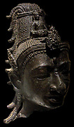 Head of Avalokitesvara around the 8th century in the style of My Son E1 Bronze. Vietnamese. Avalokitesvara 'Lord who looks down' is a bodhisattva who embodies the compassion of all Buddha's.