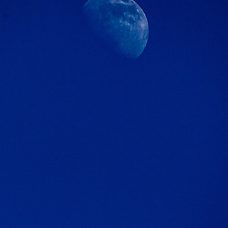 The International Space Station passes near the Moon