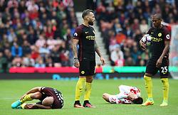 Pablo Zabaleta of Manchester City and Bojan Krkic of Stoke City lie injured on the floor - Mandatory by-line: Matt McNulty/JMP - 20/08/2016 - FOOTBALL - Bet365 Stadium - Stoke-on-Trent, England - Stoke City v Manchester City - Premier League