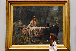 "© Licensed to London News Pictures. 05/09/2018. LONDON, UK.  A staff member views ""The Lady of Shalott"", 1888, by John William Waterhouse, at Tate Britain, to mark the launch of a major new exhibition at the National Gallery of Australia (NGA) in December 2018.  Over forty Pre-Raphaelite works will be loaned by Tate to NGA, which have never been shown in Australia until now, including ""Ophelia"", 1851-52, by John Everett Millais and ""The Lady of Shalott"", 1888, by John William Waterhouse.  Photo credit: Stephen Chung/LNP"