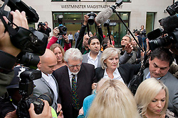 © Licensed to London News Pictures. 23/09/2013. London, UK. Surrounded by media and minders, Artist and television celebrity Rolf Harris is seen leaving Westminster Magistrates Court in London today (23/09/2013). Harris, 83, has been charged with nine counts of indecent assault and four counts of making indecent images of a child. The alleged indecent assaults date from 1980 to 1986 and relate to two complainants aged 14 and 15 at the timePhoto credit: Matt Cetti-Roberts/LNP