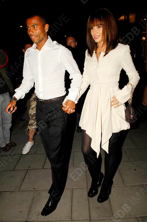08.AUGUST.2007. LONDON<br /> <br /> ASHLEY AND CHERYL COLE LEAVING CIPRIANI&rsquo;S RESTAURANT, MAYFAIR AT 11.30PM AFTER HAVING DINNER WITH A COUPLE OF FRIENDS THEY THEN ALL GOT INTO ASHLEY&rsquo;S CAR AND WENT BACK TO THEIR FRIENDS HOUSE IN NOTTING HILL AND LEFT 2 HOURS LATER AT 1.30AM WITH CHERYL LOOKING LIKE SHE HAS HAD A BIT TO MUCH TO DRINK AND LOOK AT THE MASSIVE DIAMOND ROCK ON CHERYL&rsquo;S FINGER.<br /> <br /> BYLINE: EDBIMAGEARCHIVE.CO.UK<br /> <br /> *THIS IMAGE IS STRICTLY FOR UK NEWSPAPERS AND MAGAZINES ONLY*<br /> *FOR WORLD WIDE SALES AND WEB USE PLEASE CONTACT EDBIMAGEARCHIVE - 0208 954 5968*