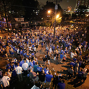 March 31, 2012 - Lexington, Kentucky, USA - University of Kentucky basketball fans fill State Street as they celebrate their team's victory over the University of Louisville in Lexington, Ky., on March 31, 2012. The win for Kentucky advances them to the championship game of the NCAA tournament in New Orleans. Fans took to the streets and in burned couches, turned over a car and ending with a handful of arrests. (Credit image: © David Stephenson/ZUMA Press)
