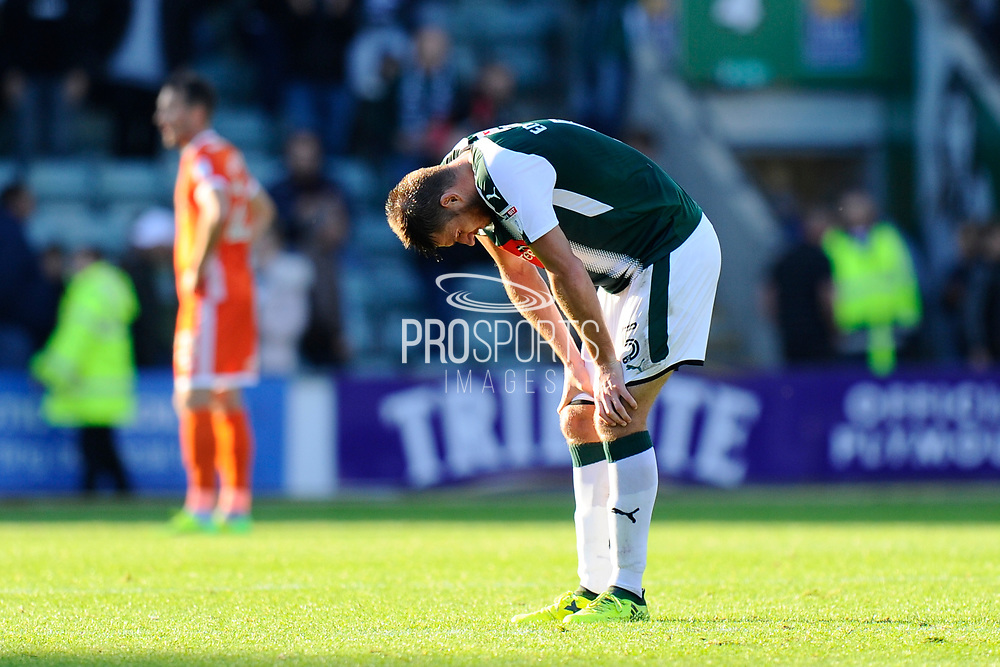 Ryan Edwards (5) of Plymouth Argyle looks exhausted at full time in the 1-1 draw during the EFL Sky Bet League 1 match between Plymouth Argyle and Shrewsbury Town at Home Park, Plymouth, England on 14 October 2017. Photo by Graham Hunt.