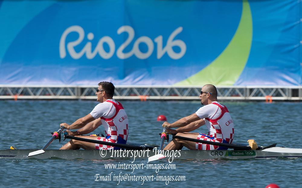 Rio de Janeiro. BRAZIL.  Gold  Medalist CRO M2X. . Bow. Martin SINKOVIC and Valent<br /> SINKOVIC,  2016 Olympic Rowing Regatta. Lagoa Stadium,<br /> Copacabana,  &ldquo;Olympic Summer Games&rdquo;<br /> Rodrigo de Freitas Lagoon, Lagoa. Local Time 11:35:42  Thursday  11/08/2016 <br /> [Mandatory Credit; Peter SPURRIER/Intersport Images]
