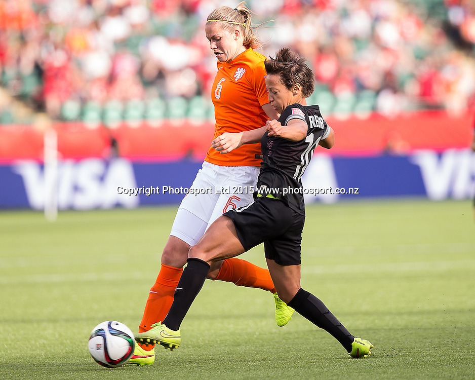 Sarah Gregorius, Anouk Dekker. Edmonton, Alberta, Canada, June 6, 2015.  The opening day of the Women's World Cup at Commonwealth Stadium.  New Zealand was defeated by Netherlands 1-0.