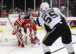 Mar 17, 2010; Newark, NJ, USA; New Jersey Devils goalie Martin Brodeur (30) makes a save on Pittsburgh Penguins defenseman Sergei Gonchar (55) during the first period at the Prudential Center.