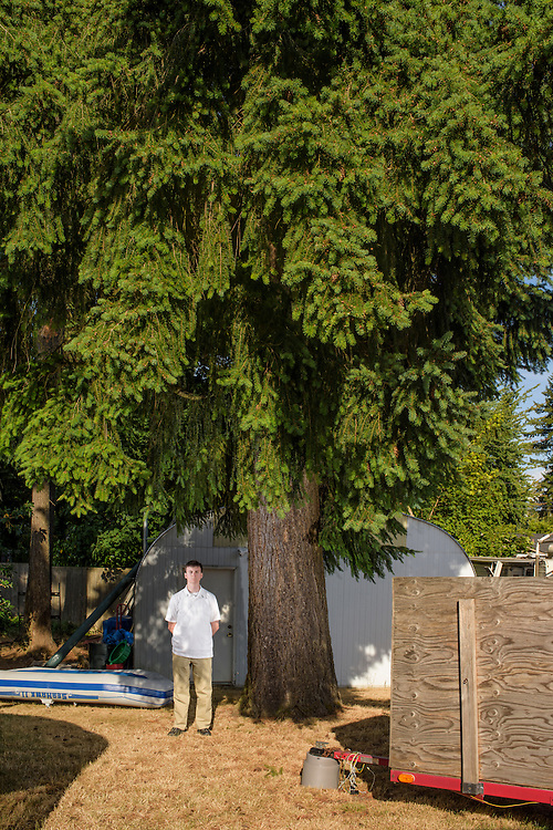 Mountlake Terrace, Washington - July 13, 2015: Uberstadt's King Adam I stands stands for a portrait in the backyard of the micronation's capital, Rosewood.<br /> <br /> The Kingdom of &Uuml;berstadt is led by nineteen-year-old King Adam I, (Adam Oberstadt). The Barony of Rosewood -- the micronation's capitol and the Oberstadt family home -- is nestled in the Seattle suburb of Mountlake Terrace, Wash. <br /> &Uuml;berstadt also claims territory of nearby Edmount Island on Lake Ballinger -- called The Barony of Ballinger and &quot;considered the spiritual homeland of the nation.&quot; Both baronies reside within the Duchy of Edmount which &quot;is situated entirely within the boundaries of the city of Mountlake Terrace, Washington,&quot; according to the &Uuml;berstadt website.<br /> &Uuml;berstadt  was founded by King Adam I and his high school friends March 6, 2010, and was governed by judges as a kritarchy. Before taking the crown, Adam was &Uuml;berstadt's chief judge. After graduation, many of the &Uuml;berstadti moved away to college and &Uuml;berstadt's populace shrank. Activities would shift from the high school to Rosewood, and the governing style morphed to a unitary constitutional monarchy. According to the micronation's website &Uuml;berstadt is a sovereign state &quot;guided by the principles of direct democracy, socialist economics, and environmentalism.&quot; <br /> <br /> CREDIT: Matt Roth