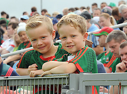.Young Mayo supporters and cousins Aaron and Christopher Feeney from Ballintubber amoung the Mayo supporters at McHale Park on saturday last.<br /> Pic Conor McKeown