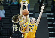 January 28, 2012: Purdue Boilermakers guard Courtney Moses (15) tries to put up a shot around Iowa Hawkeyes guard Jaime Printy (24) and Iowa Hawkeyes center Morgan Johnson (12) during the NCAA women's basketball game between the Purdue Boilermakers and the Iowa Hawkeyes at Carver-Hawkeye Arena in Iowa City, Iowa on Saturday, January 28, 2012.