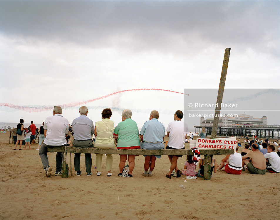Seaside spectators enjoy fly-past by the 'Red Arrows', Britain's Royal Air Force aerobatic team at Weston-super-Mare