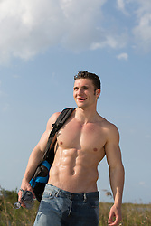 shirtless hiker walking in The Everglades