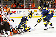 November 21, 2009:  BGSU's Nick Eno (31), Michigan center Matt Rust (19) and Michigan wing Carl Hagelin (12) during the NCCA hockey game between Michigan and the Bowling Green State University at Lucas County Arena in Toledo, Ohio.