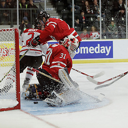COBOURG, - Dec 16, 2015 -  Game #9 - Canada East vs Canada West at the 2015 World Junior A Challenge at the Cobourg Community Centre, ON. Canada East scores a goal on Matthew Murray #31 of Team Canada West during the first period<br /> (Photo: Amy Deroche / OJHL Images)