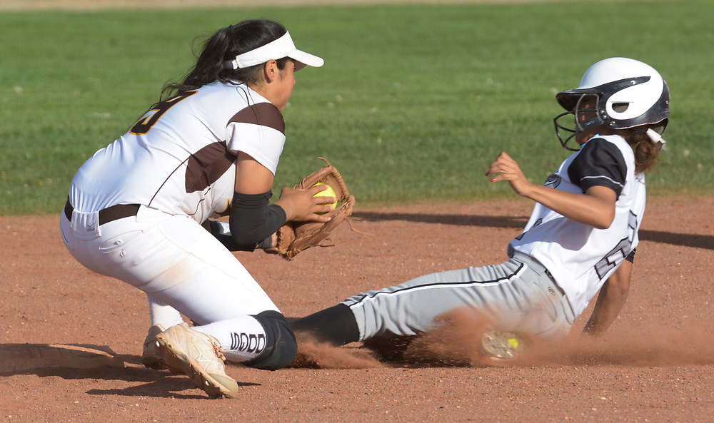 gbs040617u/SPORTS -- Volcano Vista's Alyssa Dilley, 2, steals second base beating the throw to Cibola's Amanda Moreno in the fifth inning during the game at Cibola on Thursday, April 6, 2017. (Greg Sorber/Albuquerque Journal)