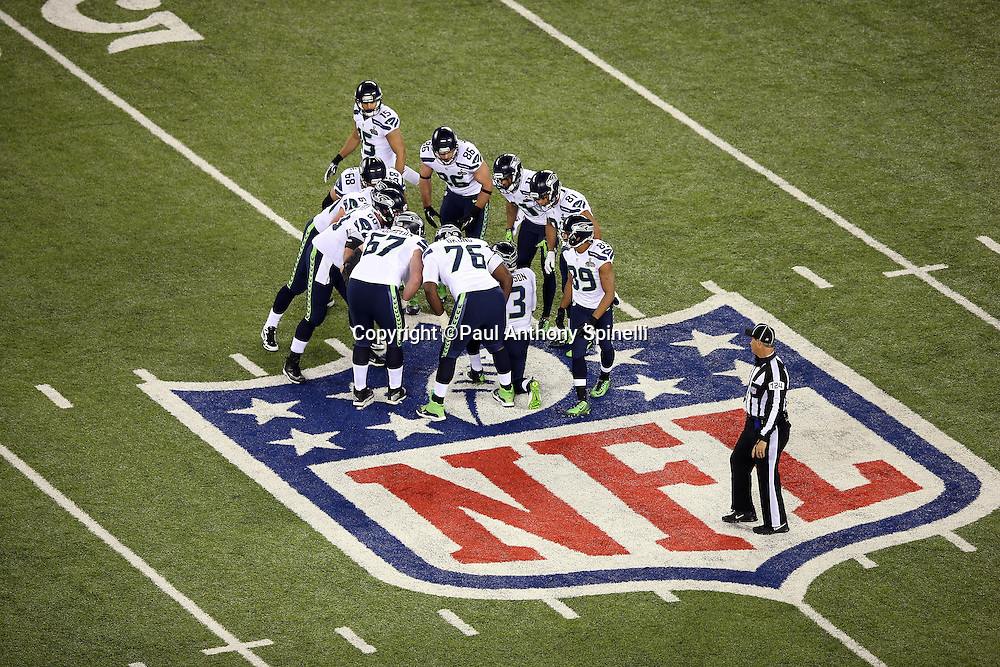 The Seattle Seahawks offense huddles and calls a play during the NFL Super Bowl XLVIII football game against the Denver Broncos on Sunday, Feb. 2, 2014 in East Rutherford, N.J. The Seahawks won the game 43-8. ©Paul Anthony Spinelli
