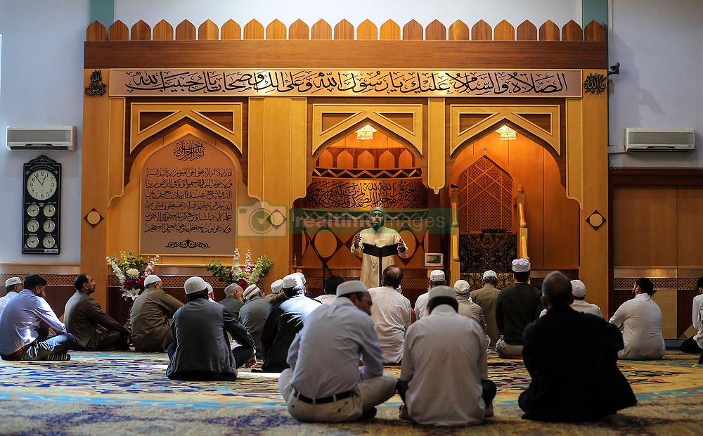 Muslim men attend Friday prayers at Manchester Central Mosque following the terror attack in the city earlier this week.