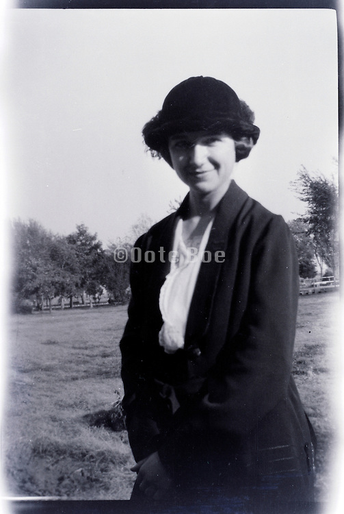 fashionable young adult woman smiling countryside USA 1920s