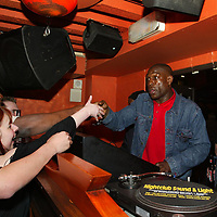 Bruno at The Ice Factory...13.4.2003<br />Heavyweight DJ Frank Bruno says hello to fans as he gets behind the decks in the Casbah bar in the Ice Factory nightclub in Perth, in the early hours of Sunday morning.<br /><br />Picture by John Lindsay .<br />COPYRIGHT: Perthshire Picture Agency.<br />Tel. 01738 623350 / 07775 852112.