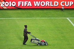 Grass cutter after the Group A first round 2010 FIFA World Cup South Africa match between South Africa and Mexico at Soccer City Stadium on June 11, 2010 in Johannesburg, South Africa.  (Photo by Vid Ponikvar / Sportida)