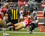 Nov 26, 2017; Santa Clara, CA, USA; Seattle Seahawks running back J. D. McKissic is tackled by defensive back Leon Hall (20) against the San Francisco 49ers at Levi's Stadium.  Seattle beat San Francisco 24-13.