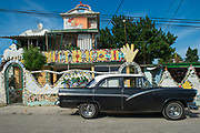 A vintage car parked in Jaimanitas, a community on the northwestern edge of Havana, Cuba, on December 12, 2016. Today, this community is known as Fusterlandia, and is the home, studio and artistic dream of artist José Rodriguez Fuster, who has decorated over 80 houses with ornate murals and domes to suit the personality of his neighbours. Fuster has also built a chess park with giant boards and tables, The Artists' Wall composed of a quilt of dozens of tiles signed and donated by other Cuban artists, a theatre and public swimming pools.