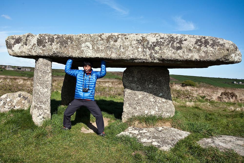 Japanese rock climber Toru Nakajima at 'Lanyon Quoit' in Cornwall, England