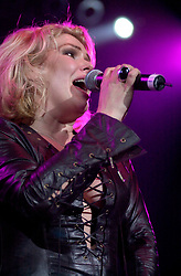 Kim Wilde steps out of the her TV Gardening clothes and Back on Stage to Tour with<br /><br />Steve Starnge (Visage)<br />Claire Grogan (Altered Images)<br />The Belle Stars<br />Dollar<br />Kim Wilde<br />The Human League<br />Play on the Here and Now  Christmas Party Tour at Sheffields Hallam FM Arena Friday 13th December 2002<br /><br />[#Beginning of Shooting Data Section]<br />Nikon D1 <br />2002/12/13 22:51:24.2<br />JPEG (8-bit) Fine<br />Image Size:  2000 x 1312<br />Color<br />Lens: 80-200mm f/2.8-2.8<br />Focal Length: 80mm<br />Exposure Mode: Manual<br />Metering Mode: Spot<br />1/200 sec - f/2.8<br />Exposure Comp.: 0 EV<br />Sensitivity: ISO 800<br />White Balance: Auto<br />AF Mode: AF-S<br />Tone Comp: Normal<br />Flash Sync Mode: Not Attached<br />Color Mode: <br />Hue Adjustment: <br />Sharpening: Normal<br />Noise Reduction: <br />Image Comment: <br />[#End of Shooting Data Section]