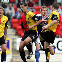 St Johnstone v Partick Thistle....25.09.04<br />Grant Murray and Adrian Madaschi block Ryan Stevenson<br /><br />Picture by Graeme Hart.<br />Copyright Perthshire Picture Agency<br />Tel: 01738 623350  Mobile: 07990 594431