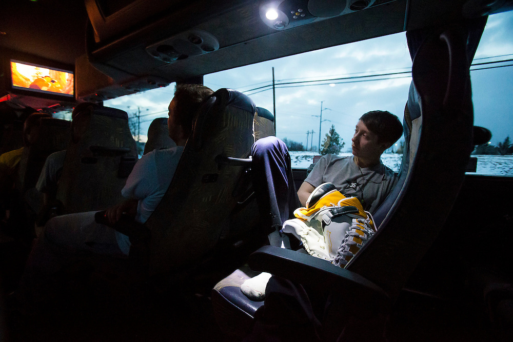 George Mason goalie, Bryan Kraus attempts to fall asleep while riding the team chartered bus to Christopher Newport University on January 25, 2014.