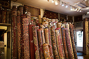 Hundreds of fine Persian rugs line the walls of Borokhim's Oriental Rugs on Monroe Street, Monday, April 24, 2017.
