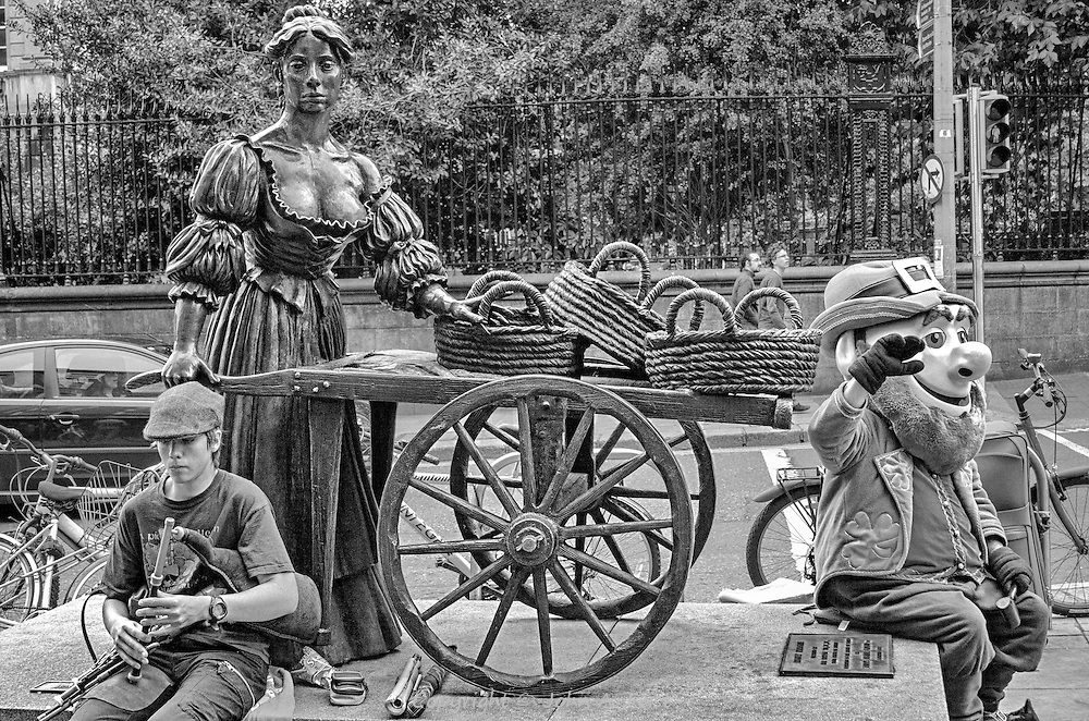 As the song goes...In Dublin fair city, where the girls are so pretty, there lives a young lady named Molly Malone.  This statue just sits on a street corner.  The leprechaun and lad playing the pipes were fortunate additions.  I wonder if she actually peddled her cockles and mussels on that street?
