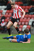 Asa Hall and Mark Hughes during the FA Trophy match between Cheltenham Town and Chelmsford City at Whaddon Road, Cheltenham, England on 12 December 2015. Photo by Antony Thompson.