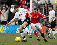 Photo: Paul Thomas. Nottingham Forest v Derby County. Forest Ground, Nottingham. Coca Cola Championship. 26/02/2005. Grzegorz Rasiak and Paul Evans battle for the ball.
