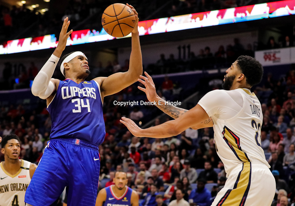 Oct 23, 2018; New Orleans, LA, USA; Los Angeles Clippers forward Tobias Harris (34) drives at New Orleans Pelicans forward Anthony Davis (23) during the second quarter at the Smoothie King Center. Mandatory Credit: Derick E. Hingle-USA TODAY Sports