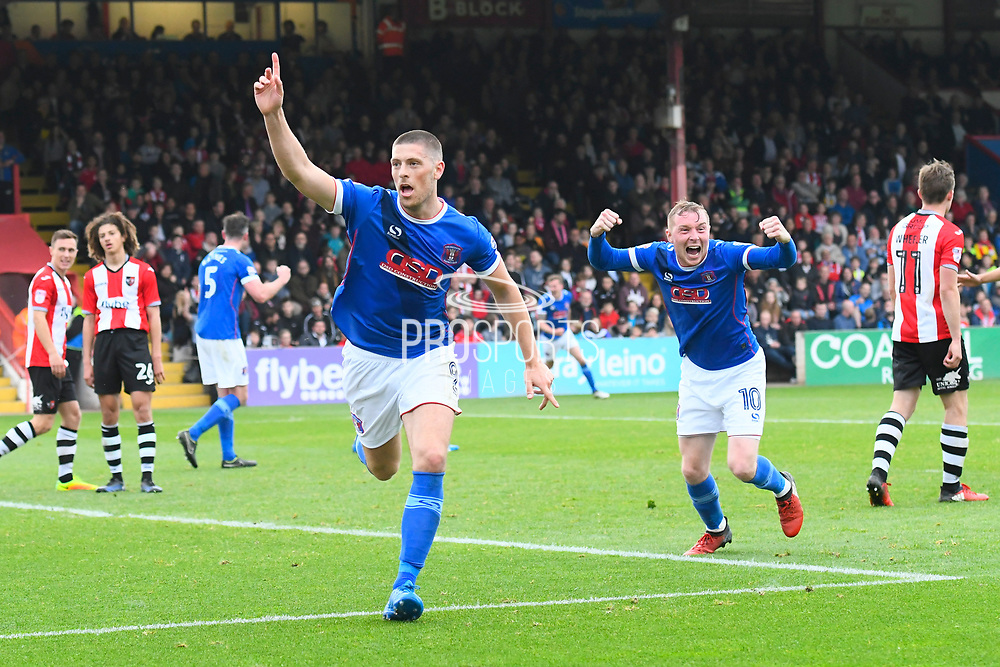 Jamie Proctor (9) of Carlisle United celebrates scoring a goal to make the score 2-3 to get his team back in the play off positions during the EFL Sky Bet League 2 match between Exeter City and Carlisle United at St James' Park, Exeter, England on 6 May 2017. Photo by Graham Hunt.