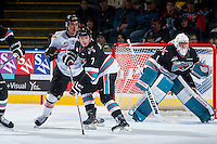 KELOWNA, CANADA - OCTOBER 24: Lucas Johansen #7 of Kelowna Rockets checks a player of the Calgary Hitmen  on October 24, 2015 at Prospera Place in Kelowna, British Columbia, Canada.  (Photo by Marissa Baecker/Shoot the Breeze)  *** Local Caption *** Lucas Johansen; Jackson Whistle;