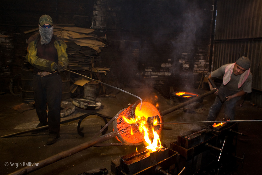 Workers pour melted copper into molds in a foundry in Santa Clara, Mexico.
