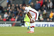 Milton Keynes Dons defender Jordan Spence (12) looks dejected at the final whistle during the Sky Bet Championship match between Milton Keynes Dons and Brighton and Hove Albion at stadium:mk, Milton Keynes, England on 19 March 2016.