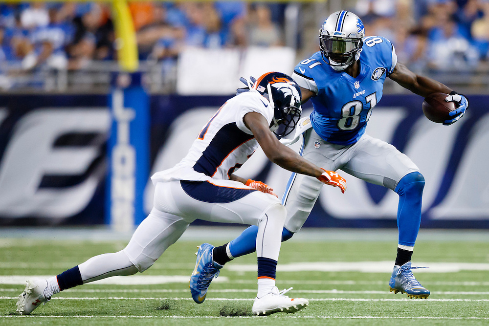 Detroit Lions wide receiver Calvin Johnson (81) runs the ball defended by Denver Broncos cornerback Aqib Talib (21) during an NFL football game at Ford Field in Detroit, Sunday, Sept. 27, 2015. (AP Photo/Rick Osentoski)