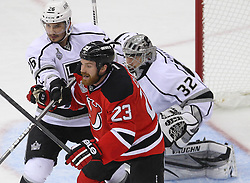 June 2; Newark, NJ, USA; Los Angeles Kings defenseman Slava Voynov (26) hits New Jersey Devils right wing David Clarkson (23) during the first period of the 2012 Stanley Cup Finals Game 2 at the Prudential Center.